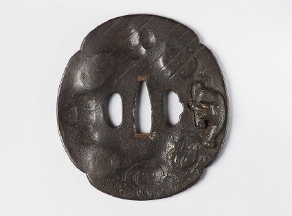 Mokkō-shaped tsuba with design of tiger and bamboo