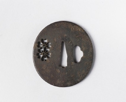 Round tsuba with design of cherry blossoms