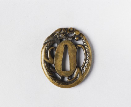 Oval tsuba in the form of a dragon chasing a pearl