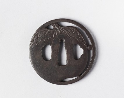 Round tsuba with design of a vegetable, possibly an aubergine