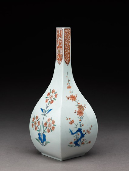 Squared bottle with prunus and formal daisy plants