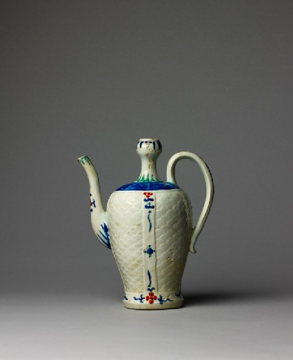 Ewer with wave pattern and stylized floral decoration