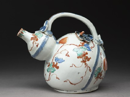Gourd-shaped ewer with moulded vine leaves