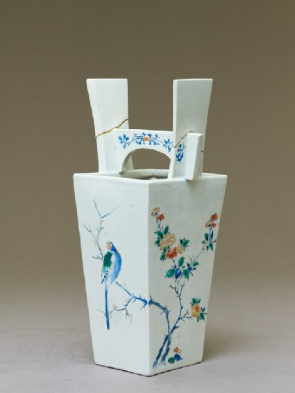 Vase with camellia tree and two birds