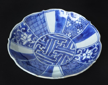 Blue-and-white dish with flowers and geometric decoration