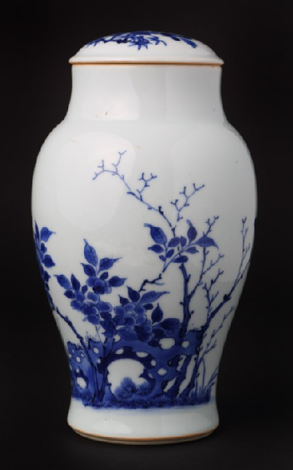 Blue-and-white jar and lid with birds, rocks, and plants