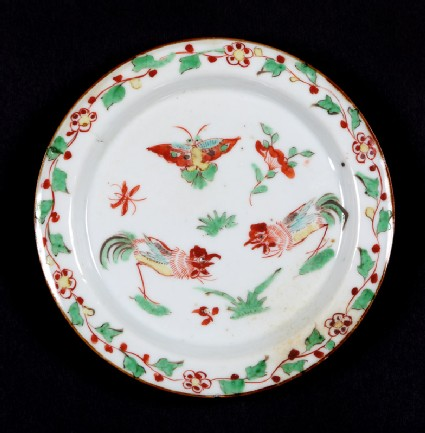 Dish with two cockerels and a butterfly