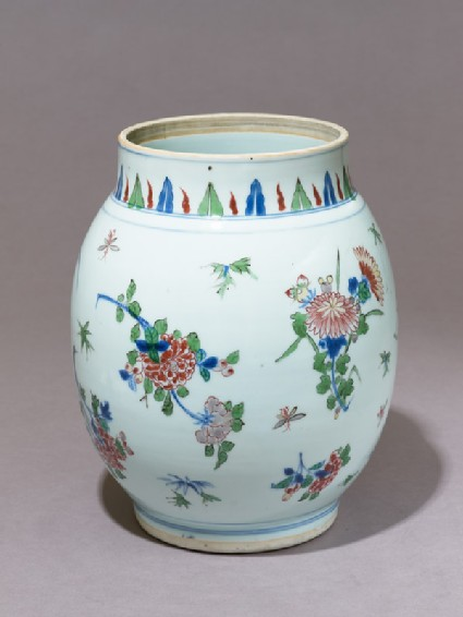 Jar with flowers and insects