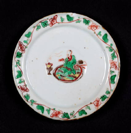Dish with seated figure reading a book
