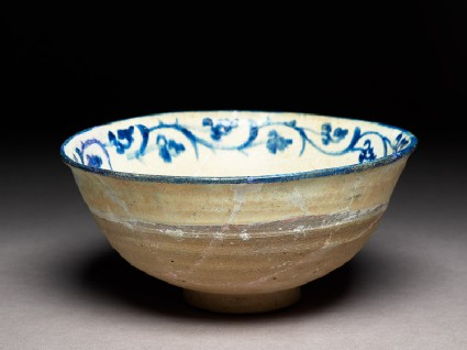 Bowl with rosette and vegetal scroll