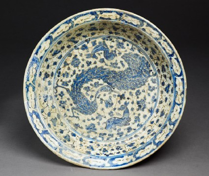 Dish with peacock and deer amid floral scrolls