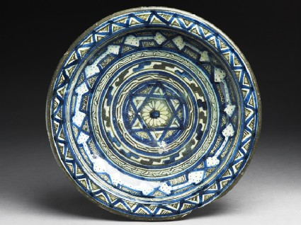 Dish with central six-pointed star and concentric bands of geometric decoration