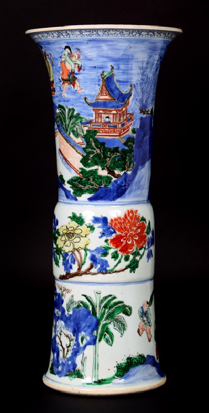 Beaker vase with flowers and figures in boats