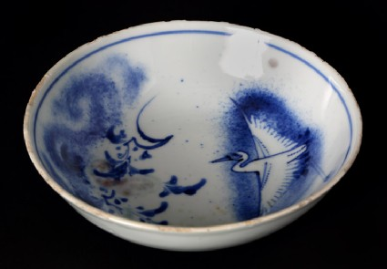 Blue-and-white bowl with crane and flowering branches
