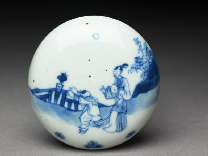 Blue-and-white box with figures in a garden