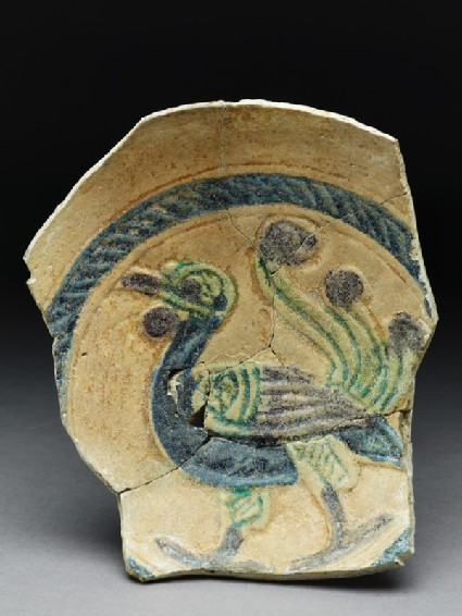 Fragment of a dish with peacock