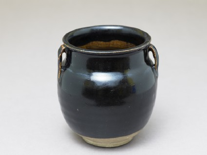 Black ware jar with black glaze