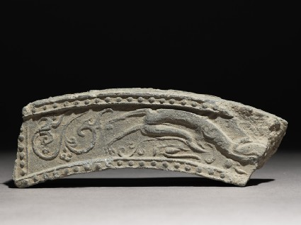 Fragment of a roof-tile with running dragon