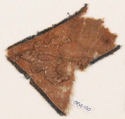 Textile fragment with flower-head and chevron