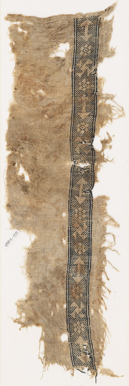 Textile fragment with an arrow, rosette, and spiral