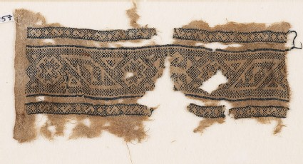 Textile fragment with bands of lozenges, stepped diamond-shapes, and triangles