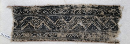 Textile fragment with leaf scrolls, palmettes, and triangles