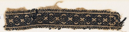 Textile fragment with linked diamond-shapes and crosses