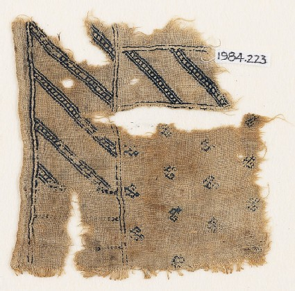 Textile fragment with diagonal stripes and crested birds