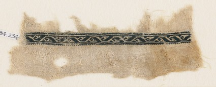 Textile fragment with vine and stylized leaf or tendril