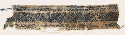 Textile fragment with diamond-shapes, spirals, and stylized tendrils