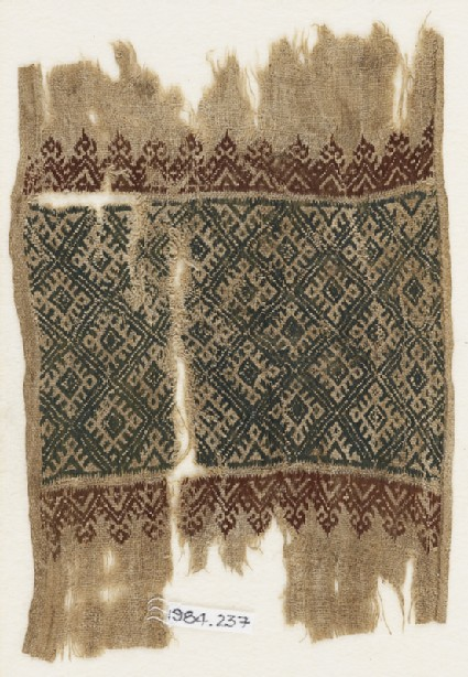 Textile fragment with linked diamond-shapes, triangles, and palmettes