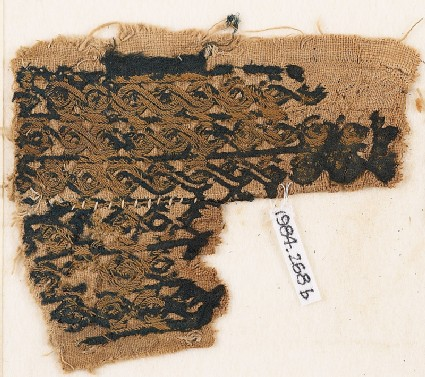 Textile fragment with bands of interlaced braid