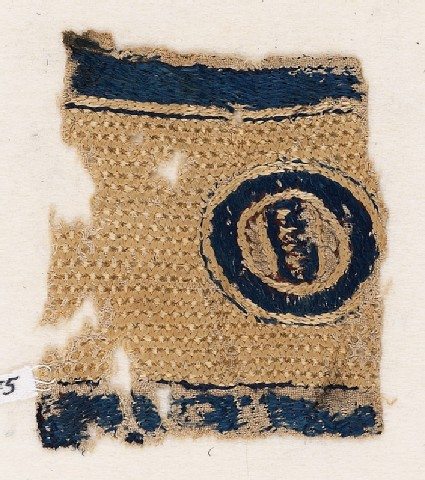 Textile fragment with circle and pseudo-inscription
