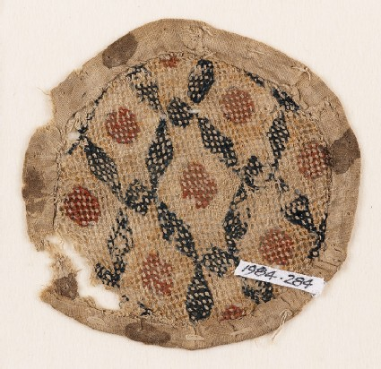 Textile fragment with rhombic shapes and squares, probably from a purse or seal-bag