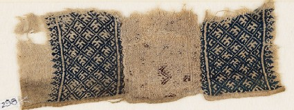 Textile fragment with grid and stylized letter