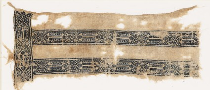 Textile fragment with linked hexagons, squares, and S-shapes