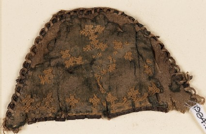 Textile fragment from a slipper front with linked crosses