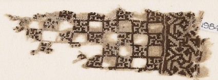 Textile fragment with linked squares and swastikas