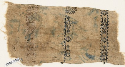 Textile fragment with triangles and diamond-shapes