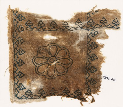 Textile fragment with rosette and palmettes, possibly from a cushion
