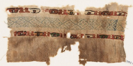 Textile fragment with two bands of ovals containing small crescents