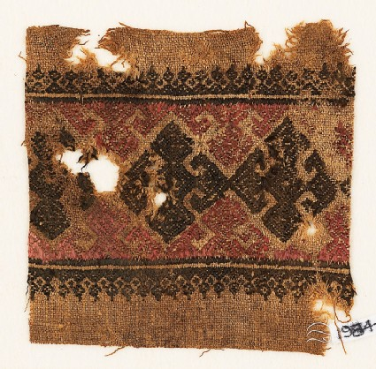 Textile fragment with three diamond-shapes and hooks