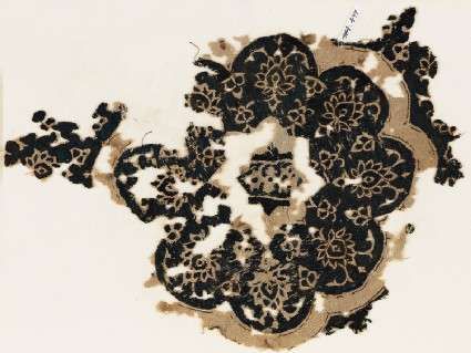 Textile fragment with eight-lobed rosette