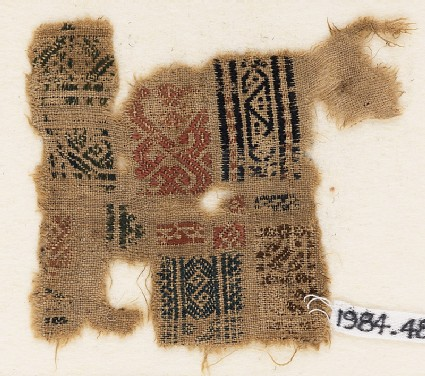 Sampler fragment with bands of S-shapes and triangles