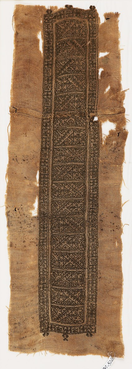 Textile fragment with hooks, lions, and crosses, possibly from a tunic
