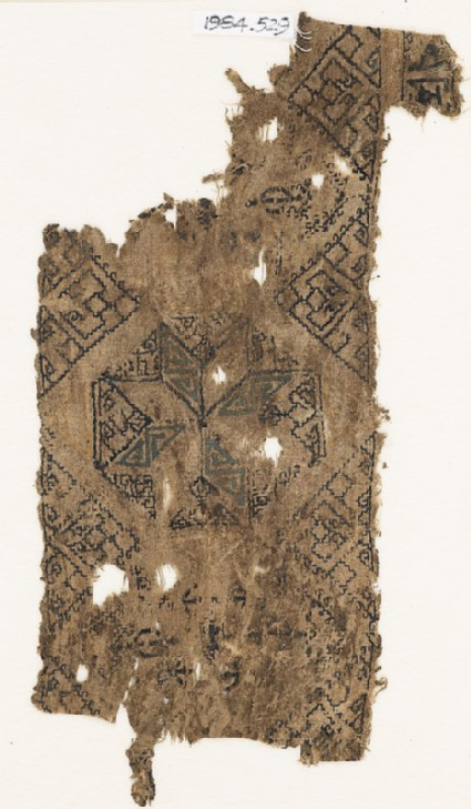 Textile fragment with octagon containing an eight-pointed star