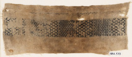Textile fragment with band of diamond-shapes and chevrons