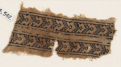 Textile fragment with chevrons and S-shapes