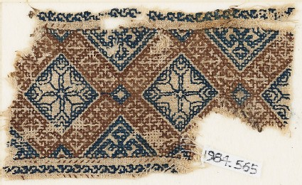 Textile fragment with eight-pointed stars surrounded by crosses