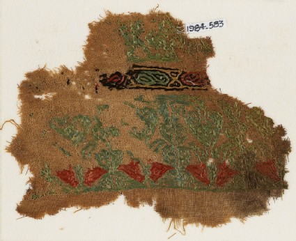 Textile fragment with pairs of birds facing each other